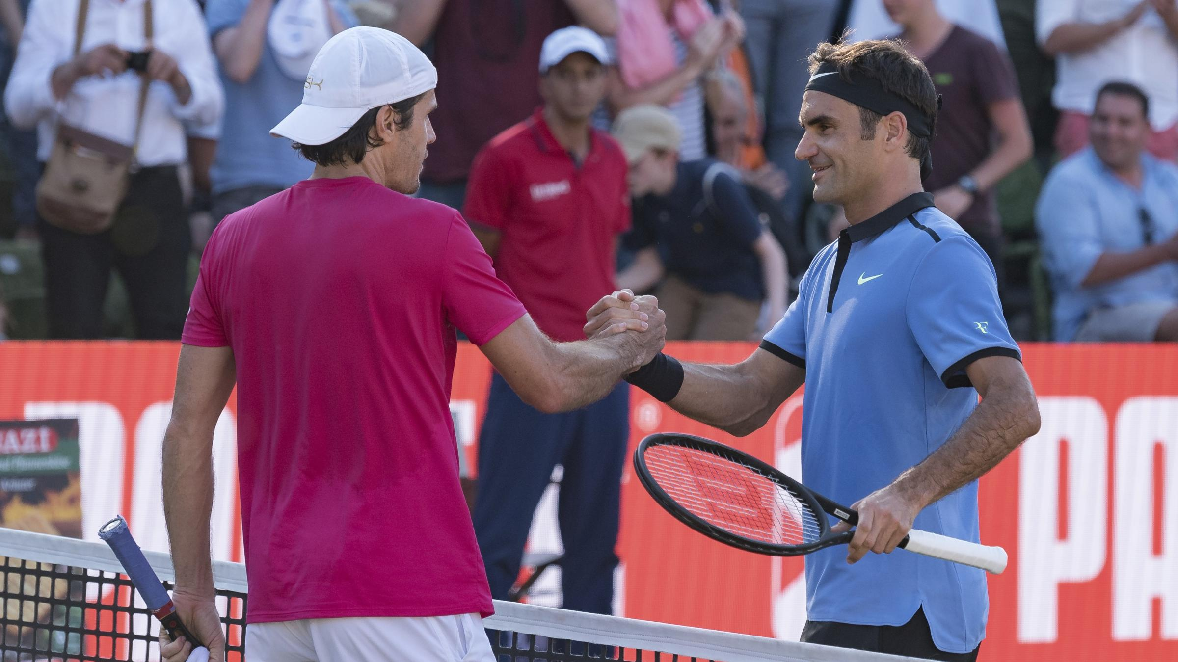 Rusty Federer ousted by Haas in Stuttgart return